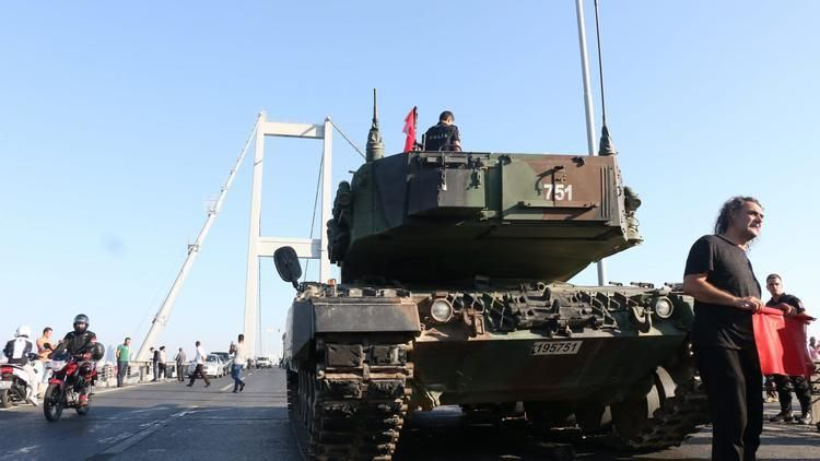 Turkish Police and supporters of Erdogan rally around military tanks on the Bosphorus Bridge where the Coup attempt started.