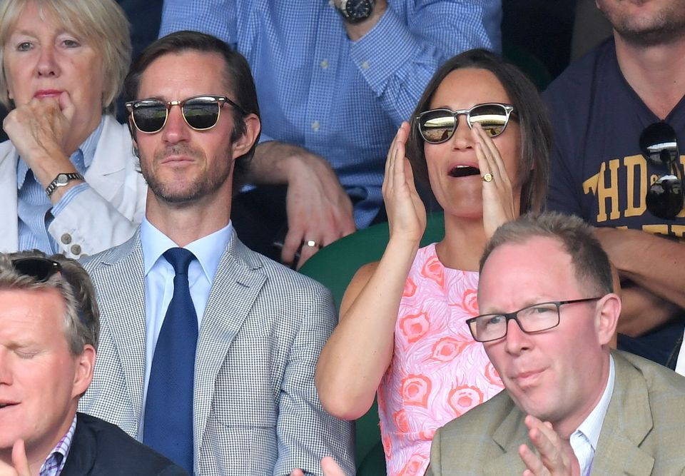 Pippa Middleton and James Matthews take in a match at Wimbledon on July 6.