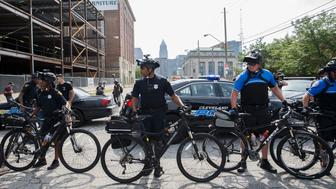Police officers on bicycles block protestors to divert them through the streets of Cleveland during the 2016 Republican National Convention on Monday, July 18, 2016 in Cleveland, Ohio. The Republican Party opened its national convention, kicking off a four-day political jamboree that will anoint billionaire Donald Trump as its presidential nominee. Some 2,000 delegates descended on a tightly secured Cleveland arena where Trump's wife will take center stage later in the day to make a personal pitch to voters that her billionaire husband is the best candidate for the White House.  / AFP / Patrick T. Fallon        (Photo credit should read PATRICK T. FALLON/AFP/Getty Images)
