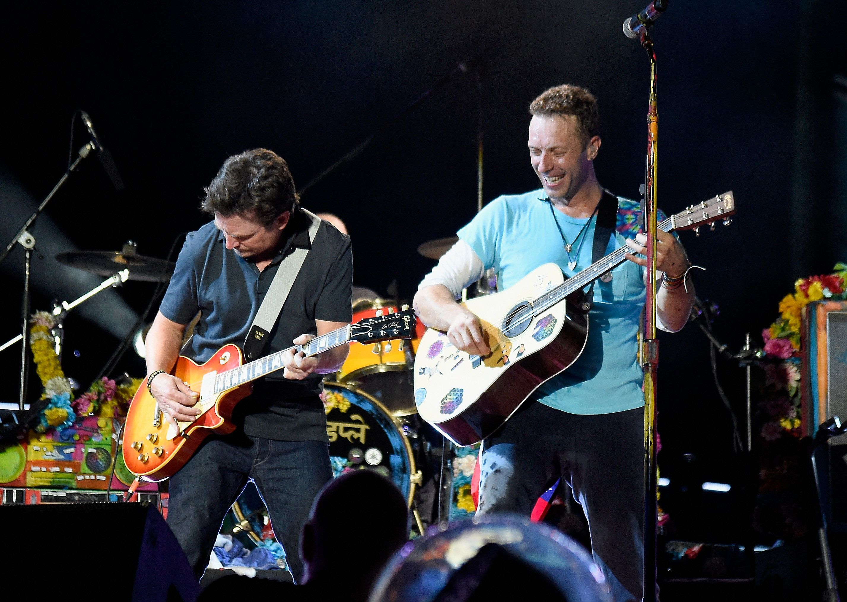 EAST RUTHERFORD, NJ - JULY 17:  Actor Michael J. Fox (L) performs onstage with recording artist Chris Martin of Coldplay during the Coldplay 'A Head Full of Dreams' Tour at MetLife Stadium on July 17, 2016 in East Rutherford, New Jersey.  (Photo by Kevin Mazur/Getty Images for Atlantic Records)