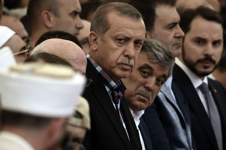 Erdogan and former Turkish President Abdullah Gul attend the funeral of a victim of the coup attempt in Istanbul on July
