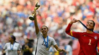 VANCOUVER, BC - JULY 05:  Alex Morgan of USA celebrates with the trophy after winning the FIFA Women's World Cup 2015 Final between USA and Japan at BC Place Stadium on July 5, 2015 in Vancouver, Canada.  (Photo by Lars Baron - FIFA/FIFA via Getty Images)