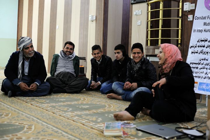 A social worker leads a discussion about FGM with men from Murtka village in Kurdistan, Iraq. In the region, more than 50 per