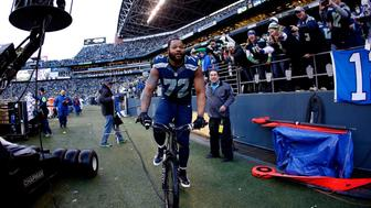 SEATTLE, WA - JANUARY 18: Michael Bennett #72 of the Seattle Seahawks rides a police bike after the Seahawks 28-22 overtime victory against the Green Bay Packers during the 2015 NFC Championship game at CenturyLink Field on January 18, 2015 in Seattle, Washington.  (Photo by Otto Greule Jr/Getty Images)