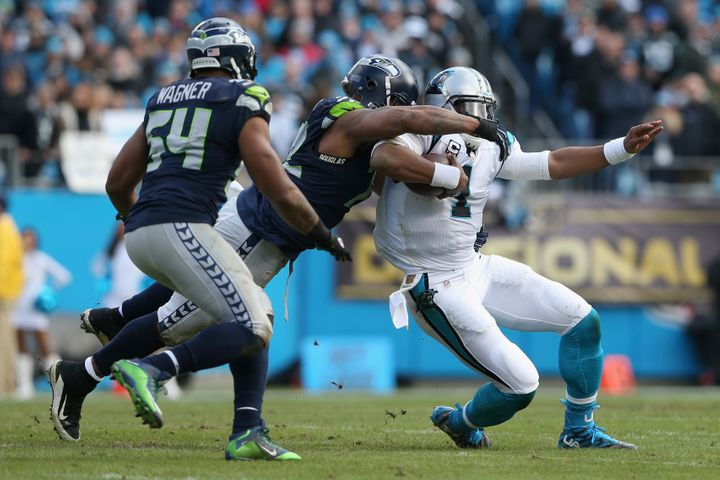 Bennett sacking the elusive Cam Newton.