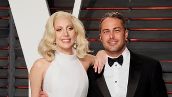 Singer Lady Gaga and her fiance Taylor Kinney arrive at the Vanity Fair Oscar Party in Beverly Hills, California February 28, 2016.  REUTERS/Danny Moloshok