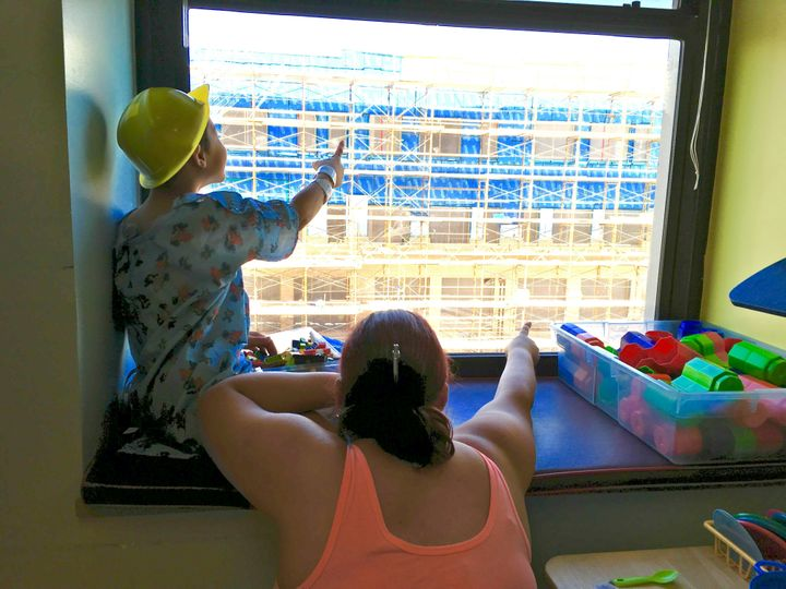 A patient and parent look for Waldo on the construction site.