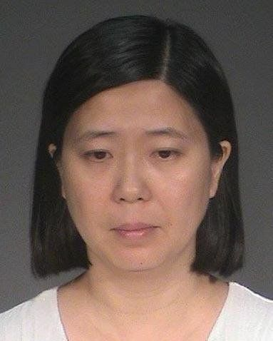 Lili Huang, 35, of Woodbury, Minnesota, faces five felony charges after allegedly enslaving and beating a nanny she brought o