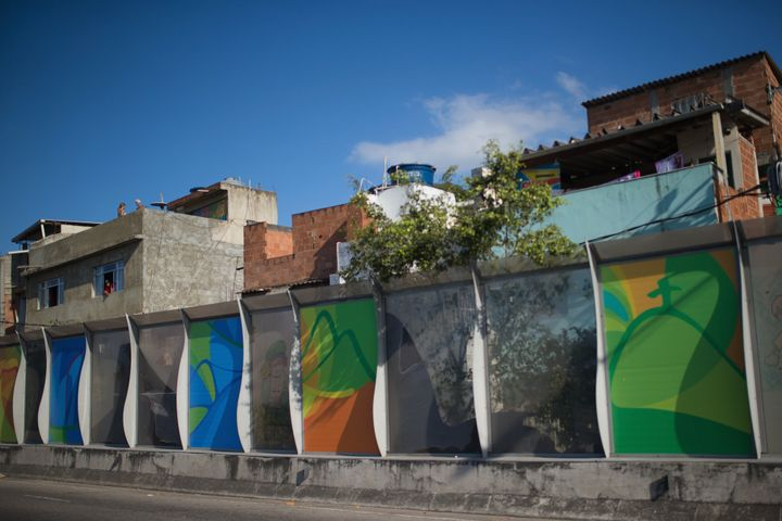 A banner advertising the 2016 Rio Olympics is seen near the Mare slums complex of the Linha Vermelha freeway.