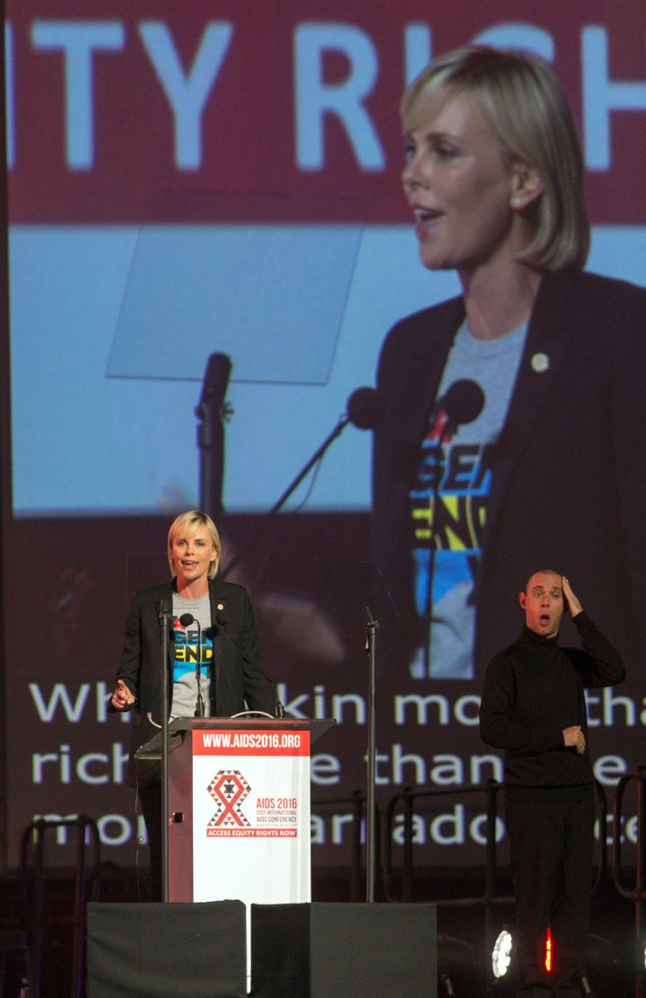 South Africa actress Charlize Theron speaks on stage during the official opening of the 21st International AIDS conference at