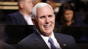 Mike Pence, presumptive 2016 Republican vice presidential nominee, smiles during the Republican National Convention (RNC) in Cleveland, Ohio, U.S., on Monday, July 18, 2016. Republican factions trying to stop Donald Trump's nomination noisily disrupted a vote on party convention rules, displaying the fissures in the party on  the first day of its national convention. Photographer: Daniel Acker/Bloomberg via Getty Images