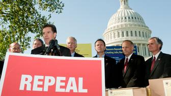 UNITED STATES – OCTOBER 5: Sen. Jim DeMint, R-S.C., speaks during a news conference at the Capitol on Wednesday, Oct. 5, 2011, to accept over 1.6 million petitions from American citizens who are urging Congress to immediately repeal Patient Protection and Affordable Care Act. In the background from left are Rep. Louie Gohmert, R-Texas, Sen. David Vitter, R-La., Sen. Ron Johnson, R-Wisc., Rep. Jeff Landry, R-La., Rep. Steve King, R-Iowa, and Rep. Robert Latta, R-Ohio. (Photo By Bill Clark/CQ Roll Call)