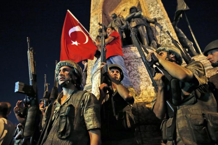 Turkish soldiers secure the area as supporters of President Recep Tayyip Erdogan protest in Istanbul's Taksim