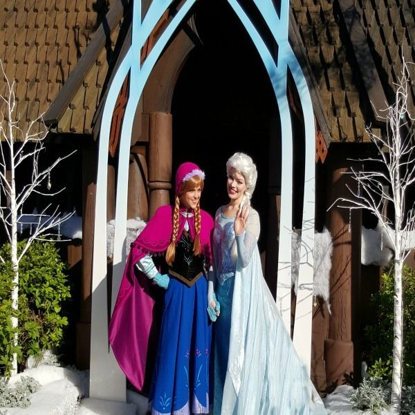 Anna and Queen Elsa greet fans during the opening ceremony for Frozen Ever After.