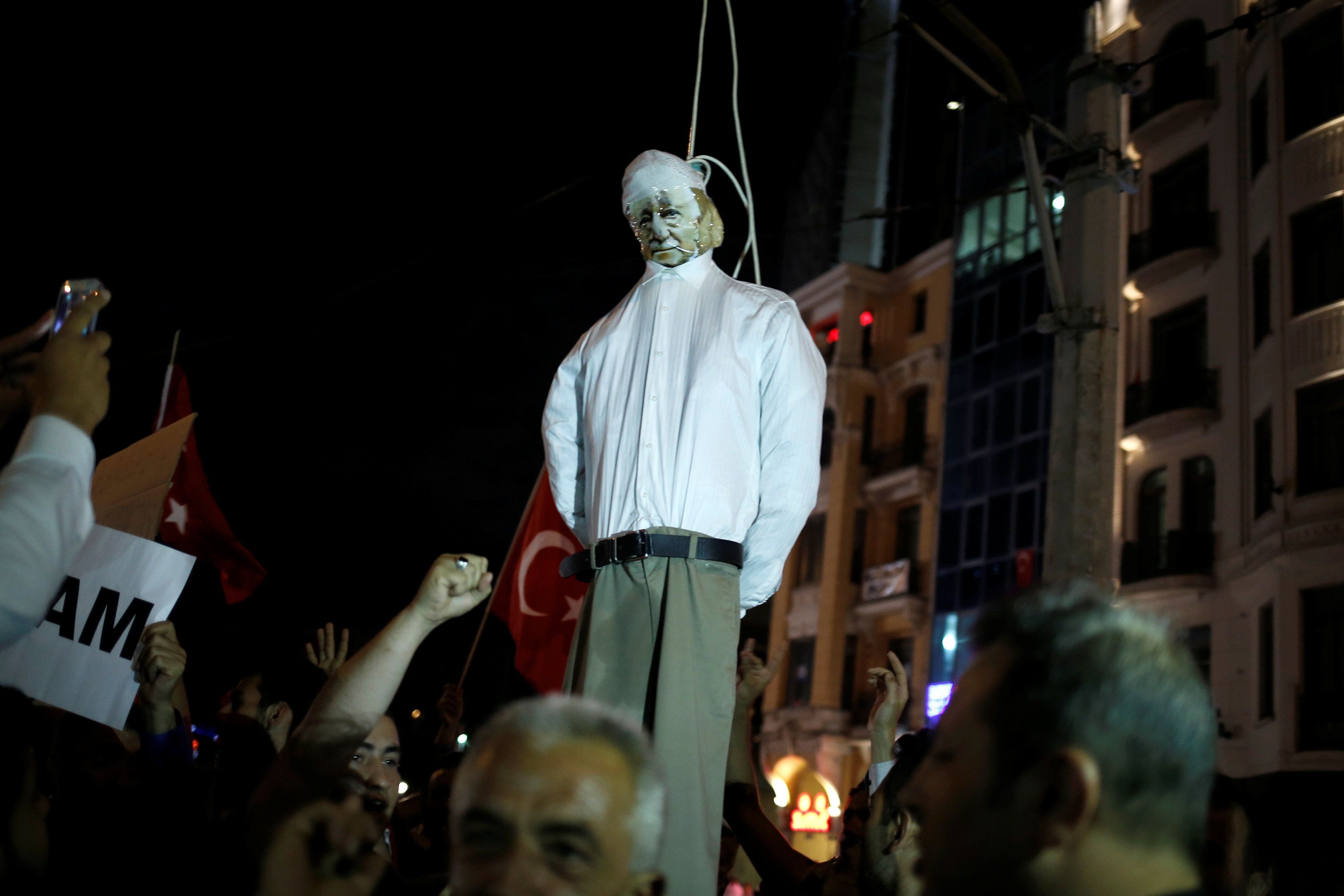 Supporters of Erdogan hold an effigy of U.S.-based cleric Fethullah Gulen hanged by a noose during a...