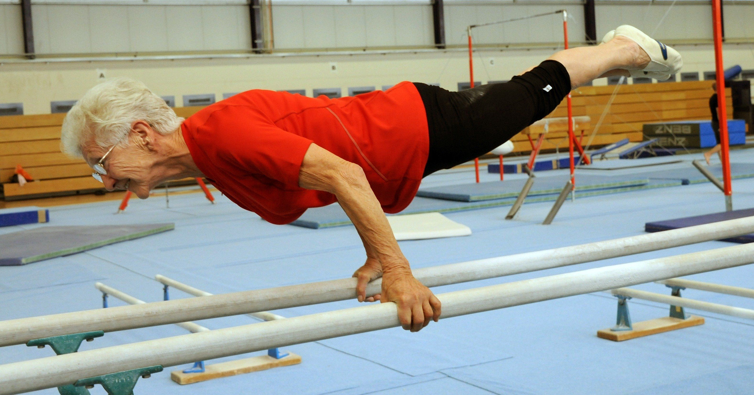 The 86-year-old Johanna Quaas, the oldest active gymnast in the world according to ??the Guinness Book of World Records, attends a weekly exercises on uneven bars on November 6,  2012 in her hometown Halle, center Germany. The gymnast who celebrates her 87 birthday on November 20 still takes part in competitions. AFP PHOTO/ Waltraud Grubitzsch/GERMANY OUT        (Photo credit should read WALTRAUD GRUBITZSCH/AFP/Getty Images)