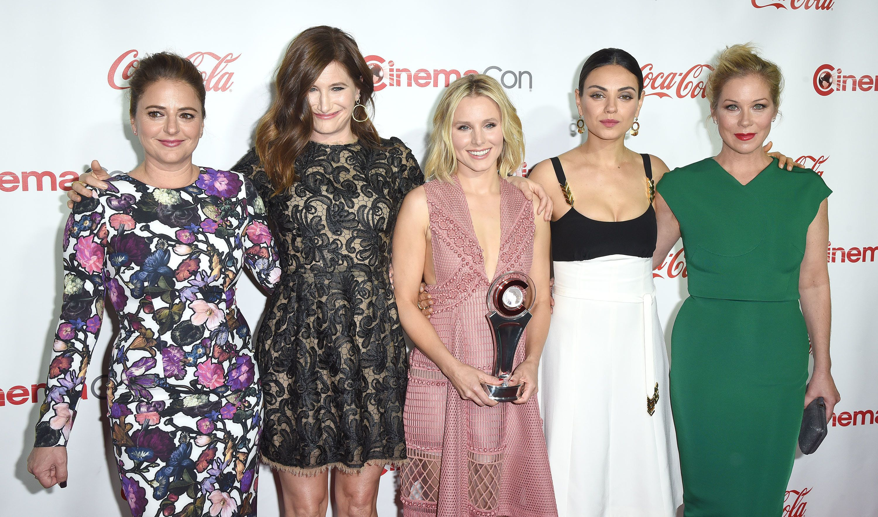 LAS VEGAS, NV - APRIL 14:  (L-R) Actress/screenwriter Annie Mumolo and actresses Kathryn Hahn, Kristen Bell, Mila Kunis and Christina Applegate, recipients of the Female Stars of the Year Award, attend the CinemaCon Big Screen Achievement Awards brought to you by the Coca-Cola Company at Omnia Nightclub at Caesars Palace during CinemaCon, the official convention of the National Association of Theatre Owners, on April 14, 2016 in Las Vegas, Nevada.  (Photo by C Flanigan/Getty Images)