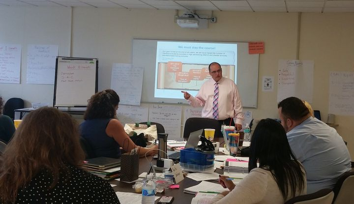 Eric Gordon, the CEO of Cleveland Metropolitan School District, talks to aspiring principals about the history of the Clevela