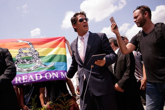Milo Yiannopoulos (centre) speaking at apress conference down the street from the Pulse Nightclub,...