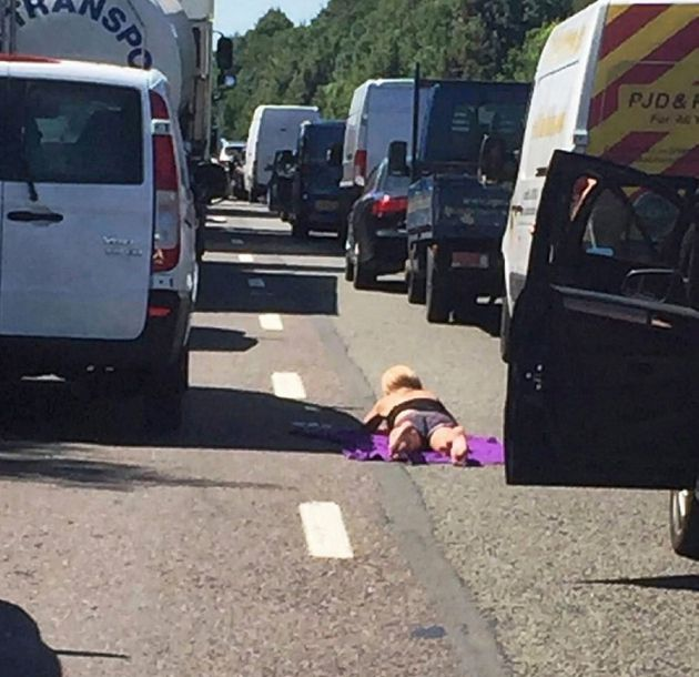 A woman catches some rays during a traffic incident