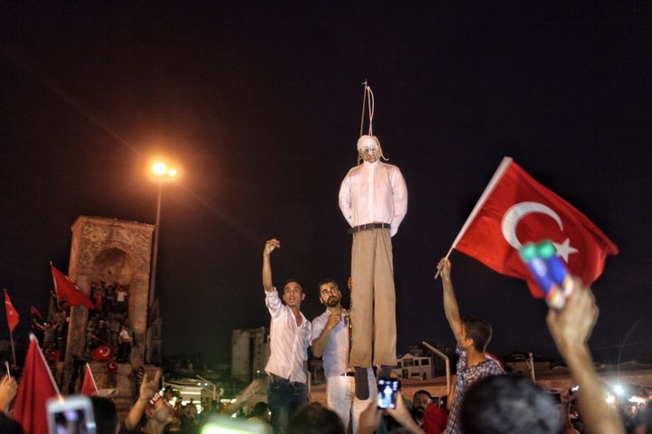 Erdogan supporters hold an effigy of the Fethullah Gulen during a pro-government demonstration in Istanbul's central Tak