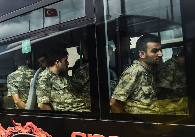 Detained Turkish soldiers arrive in a bus at the courthouse in Istanbul on Tuesday, who accused...
