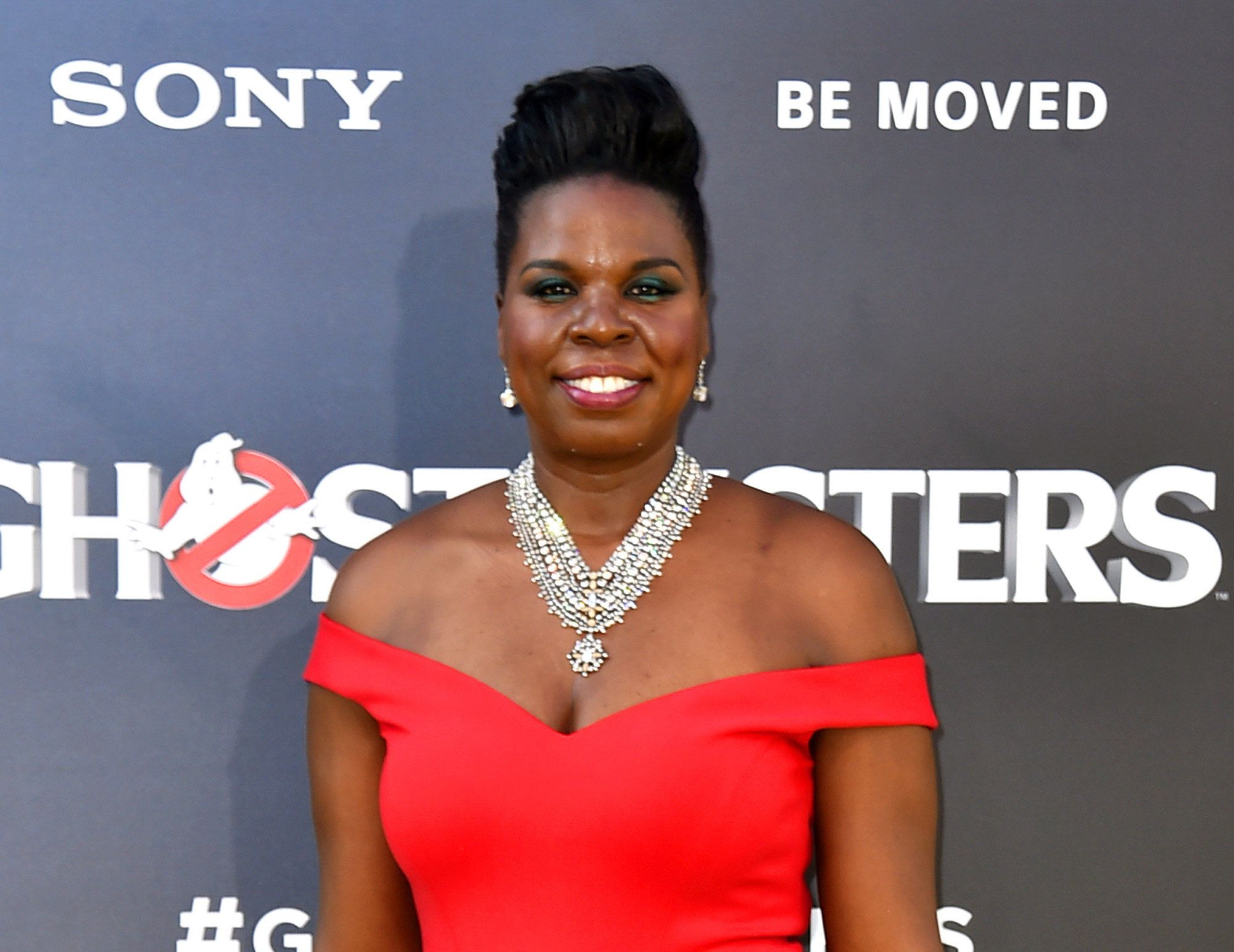 "FILE - In this July 9, 2016 file photo, Leslie Jones arrives at the Los Angeles premiere of ""Ghostbusters."" In a series of posts Monday, July 19, Jones said she had been pummeled with racist tweets. She said the messages were deeply hurtful and brought her to tears. (Photo by Jordan Strauss/Invision/AP, File)"