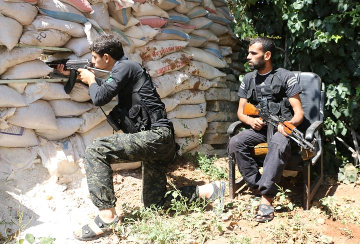 Fighters from the Syrian rebel group theNour al-Din al-Zinki Movement pictured in 2014.