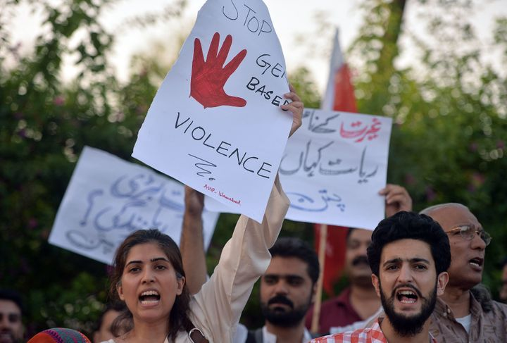 Pakistani civil society activists carry placards during a protest in Islamabad on July 18, 2016 against the murder of social