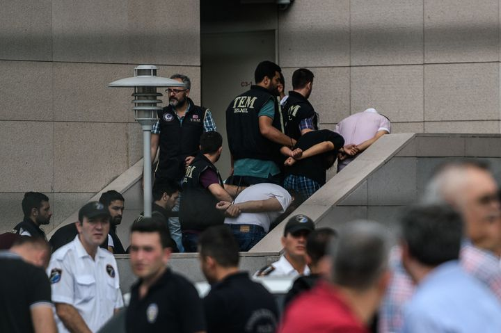 Detained Turkish soldiers who allegedly took part in a military coup arrive with their hands bound behind their backs at the