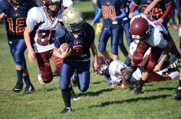 Girl's youth football sensation Sam Gordon playing during a playoff game.