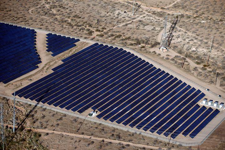 An array of solar panels in the desert in Victorville, California.