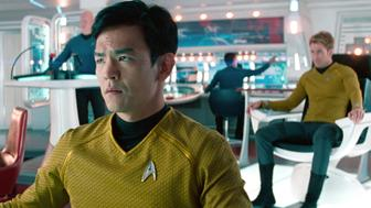 LOS ANGELES - MAY 16: John Cho as Lieutenant Hikaru Sulu and Chris Pine as Captian Kirk in the background in the 2013 movie, 'Star Trek: Into Darkness.' Release date May 16, 2013. Image is a screen grab. (Photo by CBS via Getty Images)