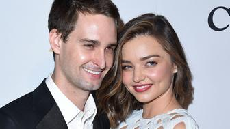 BEVERLY HILLS, CA - FEBRUARY 14:  Miranda Kerr and Evan Spiegel arrives at the 2016 Pre-GRAMMY Gala And Salute to Industry Icons Honoring Irving Azoff  at The Beverly Hilton Hotel on February 14, 2016 in Beverly Hills City.  (Photo by Steve Granitz/WireImage)