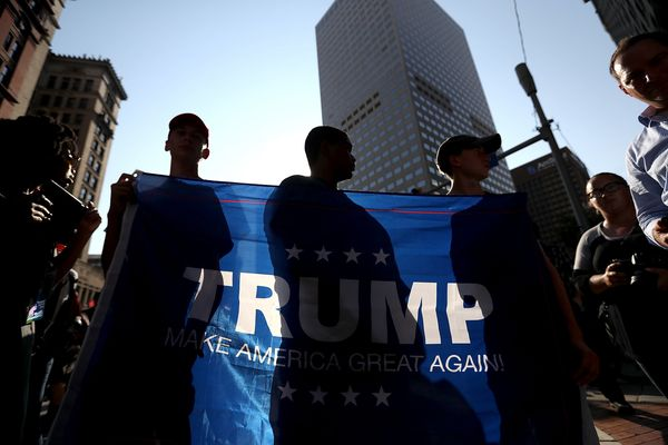 "<a href=""https://www.huffpost.com/topic/donald-trump"">Donald Trump</a> supporters hold a banner during a demonstration."