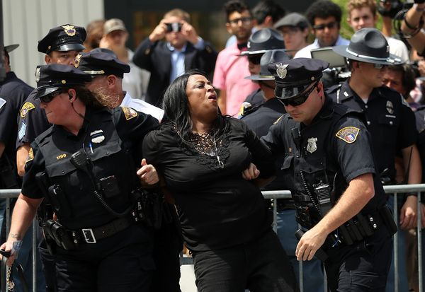 Cleveland police officers detain a protester in Cleveland Public Square.