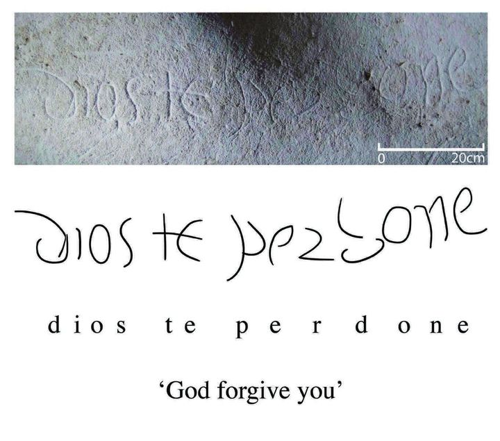 One of several inscriptions found in the cave is seen here.