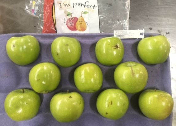 "Walmart's new ""ugly"" apples were announced shortly before Figueiredo met with the company."