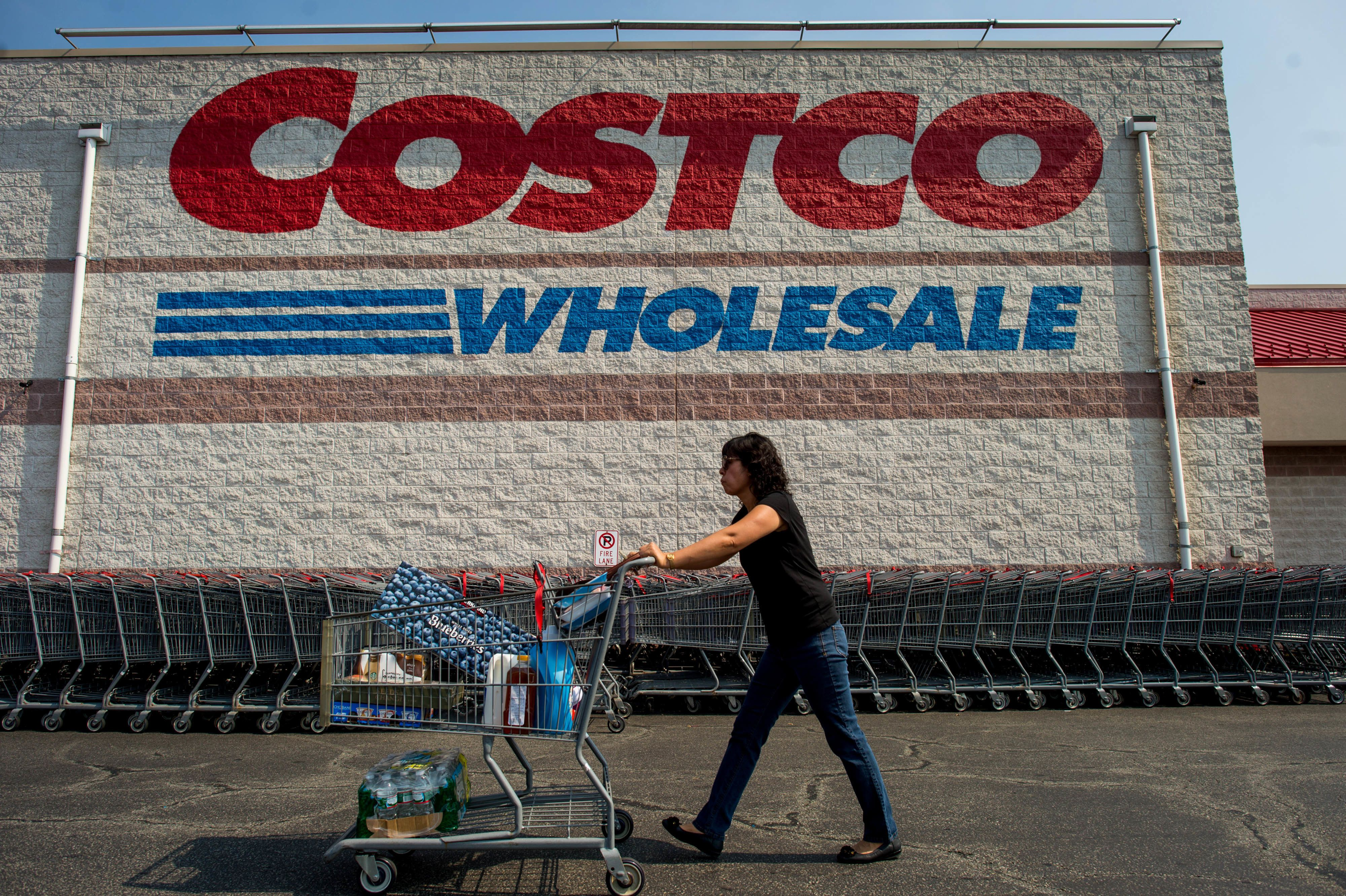 A customer pushes a cart of purchased items outside a Costco Wholesale Corp. store in Hackensack, New Jersey, U.S., on Wednesday, Sept. 11, 2013. The U.S. Census Bureau is scheduled to release business inventories data on Sept. 13. Photographer: Ron Antonelli/Bloomberg via Getty Images