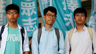 """Student leaders (from L) Joshua Wong, Nathan Law and Alex Chow pose before a verdict, on charges of inciting and participating in an illegal assembly in 2014 which led to the """"Occupy Central"""" pro-democracy movement, outside a court in Hong Kong July 21, 2016.  REUTERS/Bobby Yip     TPX IMAGES OF THE DAY"""