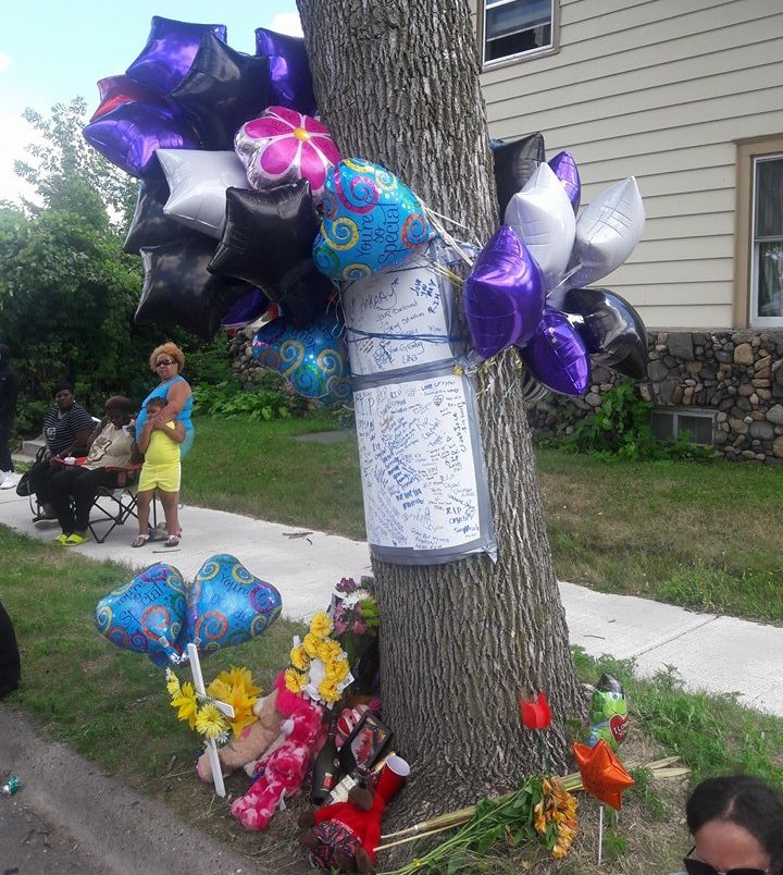 Friends, family, and neighbors flocked tothe corner of Newton Avenue North and 30th Avenue North to celebrate the life