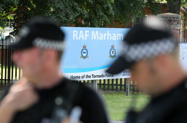 Police outside RAF Marham in Norfolk, after a serviceman was threatened with a knife near to the