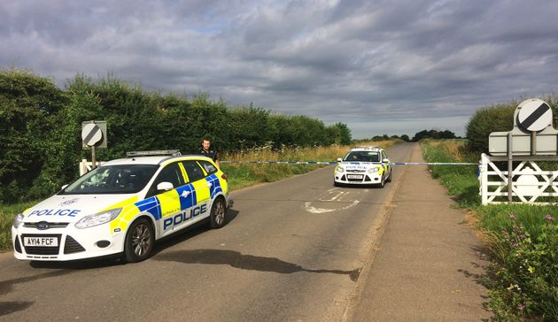 Police are hunting two men after a serviceman was threatened with a knife in