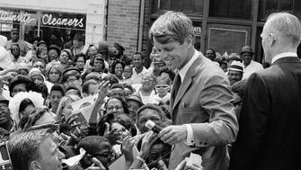 Sen. Robert Kennedy, center of picture, is roughed up from enthusiastic crowd May 4, 1968 as he carried his campaign for Tuesday's Indiana presidential primary into Black areas of Indianapolis. (AP Photo/Paul Shane)
