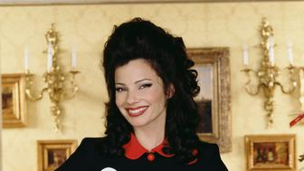 American comic actress Fran Drescher stands with arms akimbo in character as Fran Fine on the set of the CBS situation comedy 'The Nanny,' California, mid 1990s. (Photo by CBS Photo Archive/Getty Images)