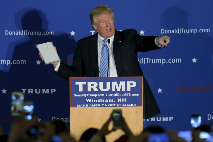 U.S. Republican presidential candidate Donald Trump holds a Bible given to him by an audience member at a campaign rally.
