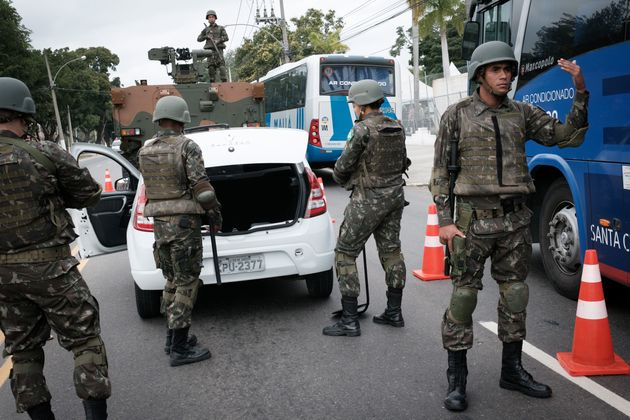 Brazilian soldiers man a checkpoint on a street near the Olympic Village in Rio de Janeiro on