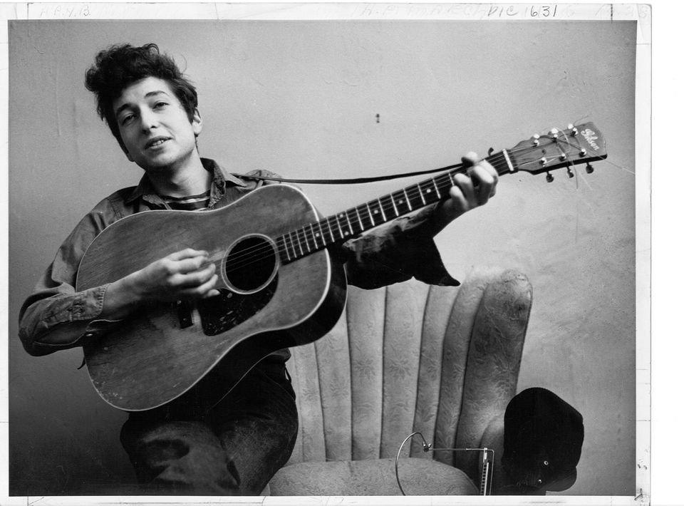 Bob Dylan poses for a portrait with his Gibson Acoustic guitar in September 1961 in New York City, New York.