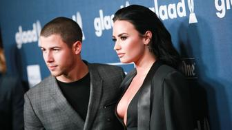 BEVERLY HILLS, CALIFORNIA - APRIL 02:  Recording artist Nick Jonas (L) and honoree Demi Lovato arrive at the 27th Annual GLAAD Media Awards at The Beverly Hilton Hotel on April 2, 2016 in Beverly Hills, California.  (Photo by David Livingston/Getty Images)