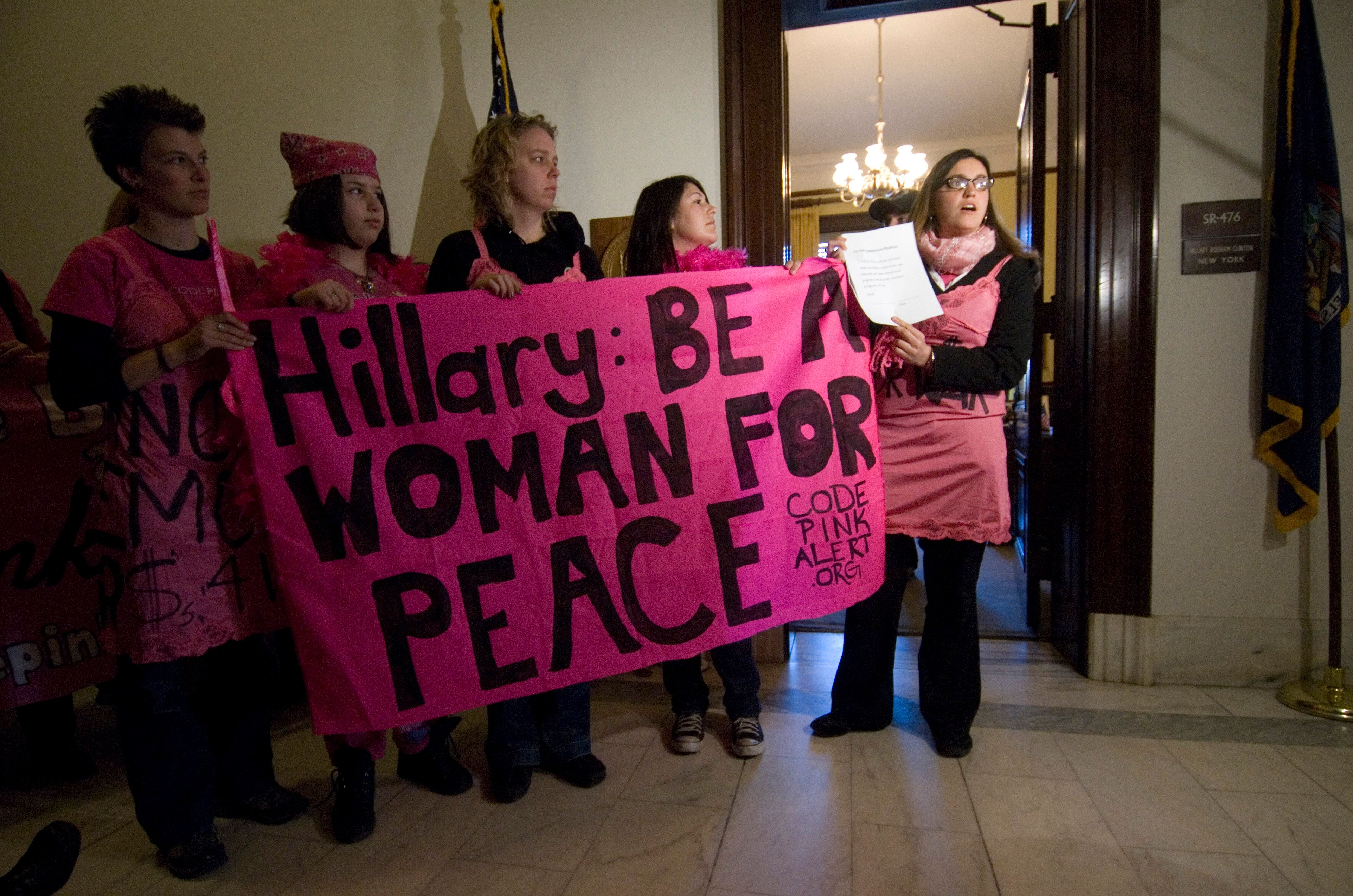 """Code Pink protesters called on Sen. Hillary Clinton in 2007 to """"dismantle her web of war."""""""